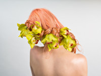 Color, flowers + loose braid interweave for a striking hairstyle